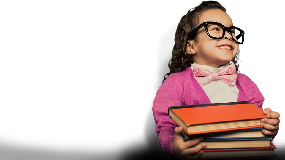 Girl pupil smiling while holding a stack of books